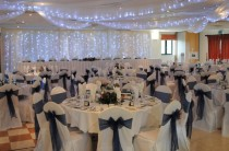 White Linen Covers, Ceiling Swags and Backdrop